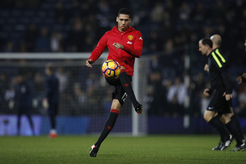 Manchester United's Chris Smalling warms up before the match