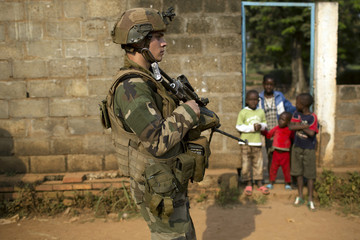 A French peacekeeping soldier patrols a street of the capital Bangui