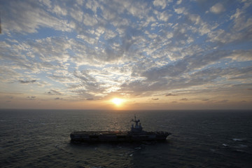 An aerial view of France's Charles de Gaulle aircraft carrier as it makes its way in the Gulf