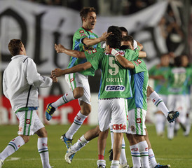 Players of Argentina's Arsenal celebrate at the end of their Copa Sudamericana soccer match against Paraguay's Olimpia in Buenos Aires