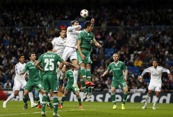 Real Madrid's Bale jumps to scores against Ludogorets during their Champions League Group B soccer match against Ludogorets at Santiago Bernabeu stadium in Madrid