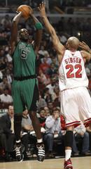 Boston Celtics' Kevin Garnett shoots on Chicago Bulls' Taj Gibson in Chicago