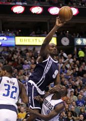 Oklahoma City Thunder forward Serge Ibaka controls a rebound over Dallas Mavericks guard Darren Collison during their NBA basketball game in Dallas, Texas