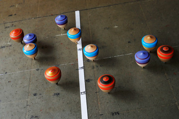 Spinning tops are seen during a performance at Sanxia old street in New Taipei City, Taiwan