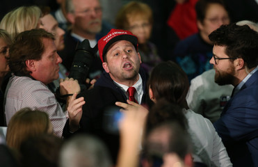 A supporter of U.S. Republican presidential candidate Donald Trump interrupts the speech of rival candidate John Kasich in Berea