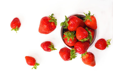 Organic fresh strawberries fruit in white cup isolate on white background