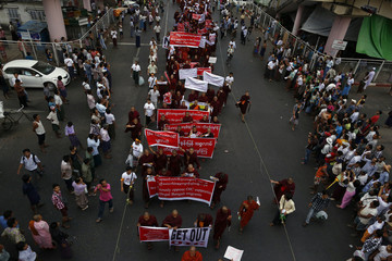 Buddhist monks and other people protest against a visit to Myanmar by a high-level delegation from the OIC, in Yangon