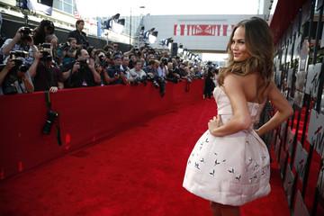 Model Chrissy Teigen arrives at the 2014 MTV Movie Awards in Los Angeles
