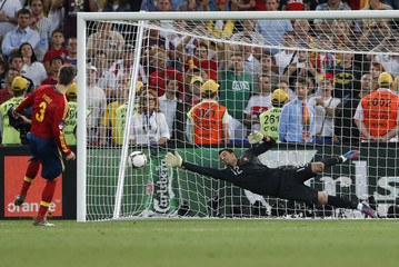 Spain's Pique scores a goal against Portugal's goalkeeper Patricio during penalty shoot-out at their Euro 2012 semi-final soccer match at Donbass Arena in Donetsk