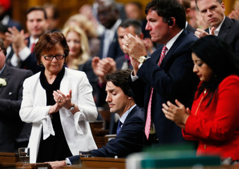 Liberal MPs applaud after Canadian Prime Minister Justin Trudeau delivered an apology in the House of Commons in Ottawa