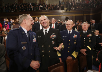 Members of the joint chiefs of staff await President Barack Obama's State of the Union speech on Capitol Hill in Washington