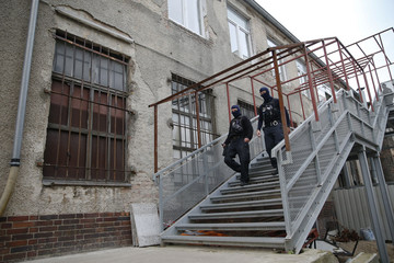 German special police members walk near a mosque association property in Berlin