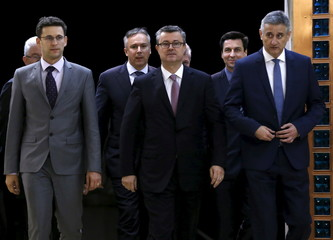 Bozo Petrov President of Most party, Croatia's Prime Minister designate Tihomir Oreskovic, Tomislav Karamarko President of Croatian Democratic Union (L-R) arrive at the Presidental office in Zagreb