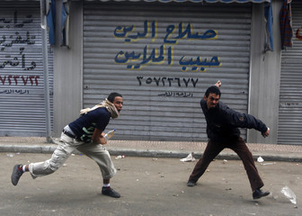 Protesters throw rocks at police during clashes in Cairo