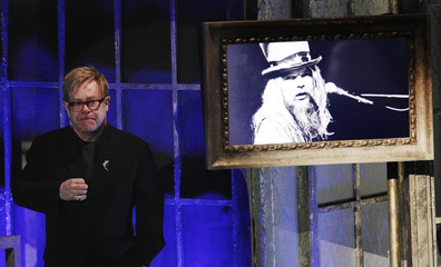 Singer Elton John weeps as he listens to Leon Russell speak during the 2011 Rock and Roll Hall of Fame induction ceremony in New York