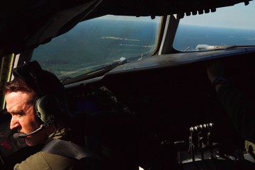United States Air Force Captain Dan DeRusha looks over his shoulder while flying a KC-10 refueling tanker on a mission to escort several F-35A fighters after taking off from McGuire Air Force Base in Wrightstown, New Jersey