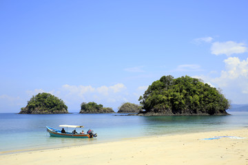 Beach with Small Isles and a Dive Boat. Coiba National Park, Panama