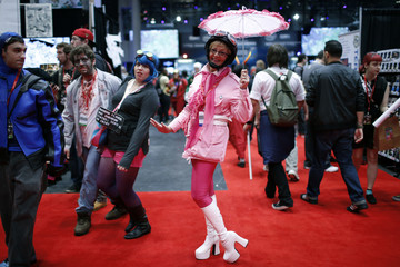 A woman dressed as Penelope Pitstop from the popular cartoon series poses for a photograph at New York's Comic-Con convention