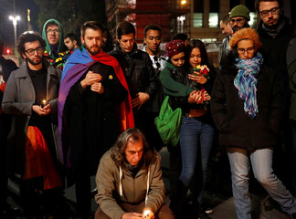 People take part in a vigil for the victims of a mass shooting at a gay nightclub in Orlando, Florida, U.S., in Sao Paulo