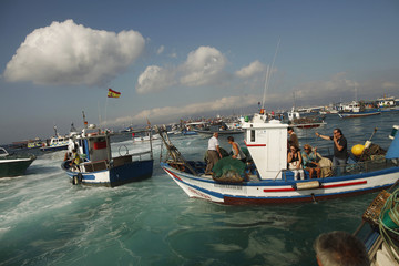 Spanish fishermen with their relatives protest in their fishing boats in Algeciras bay of La Linea de la Concepcion