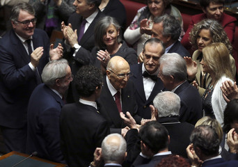 Outgoing Italian president Giorgio Napolitano acknowledges applause as he arrives at the Chambers of Deputies to begin voting for a new president in Rome