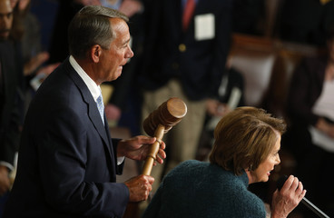 Speaker of the House Boehner holds the gavel as House Minority Leader Pelosi announces his re-election as the Speaker of the U.S. House of Representatives at the U.S. Capitol in Washington