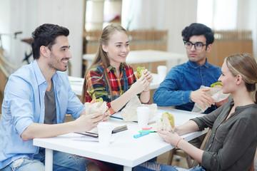 Friendly students having snack at break