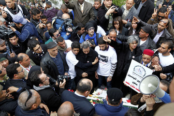 Basma, the widow, and the family of assassinated secular opposition leader Chokri Belaid, gather at his tomb to mark the 40th day of mourning after his death in Tunis