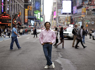Color co-founder and CEO Bill Nguyen poses on the street in New York's Times Square