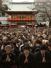 Visitors offer prayers on the first business day of the year at the Kanda Myojin Shrine in Tokyo