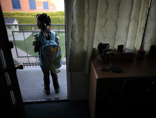 Jayla waits for her tutor to arrive at the shelter where she lives in Los Angeles