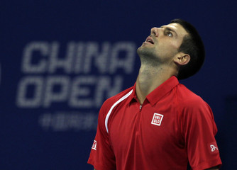 Serbia's Djokovic reacts during his match against Germany's Berrer at the China Open tennis tournament in Beijing