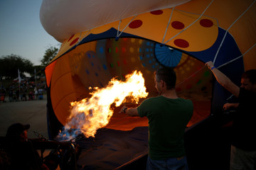 A hot air balloon is prepared for a flight during a two-day international hot air balloon festival in Eshkol Park near the southern city of Netivot