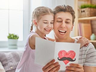 daughter congratulates dad