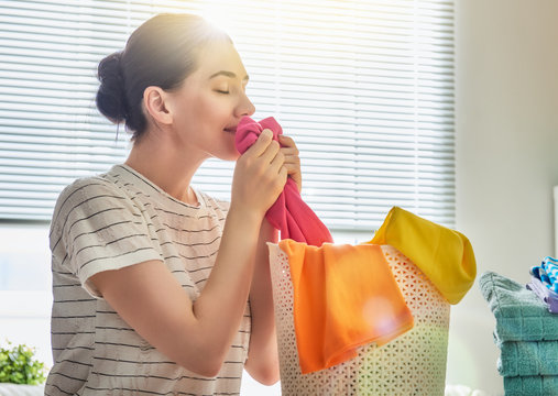 woman is smelling clean clothes