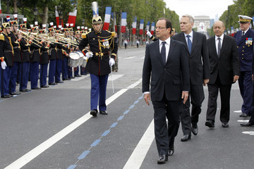 France's President Francois Hollande attends the traditional Bastille Day military parade in Paris