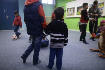 Migrant children play in playroom at refugee camp in Hameln