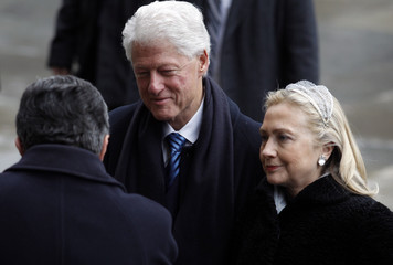 Former U.S. President Clinton and Secretary of State Hillary Clinton arrive to attend the funeral ceremony for the late former President Havel at Prague Castle's St. Vitus Cathedral