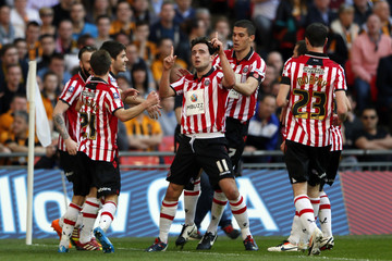 Sheffield United's Baxter celebrates with teammates after scoring against Hull City during their English FA Cup semi-final soccer match at Wembley Stadium in London