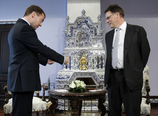 Russia's President Medvedev offers Chief Executive of Nokia Company Kallasvuo to take a seat as they meet at the presidential residence Gorki outside Moscow