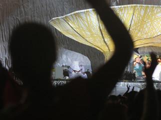 Pilgrims cheer to Pope Benedict XVI as it rains during a prayer vigil in Madrid