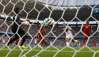 Germany's Goetze heads to score against Ghana during their 2014 World Cup Group G soccer match at the Castelao arena in Fortaleza