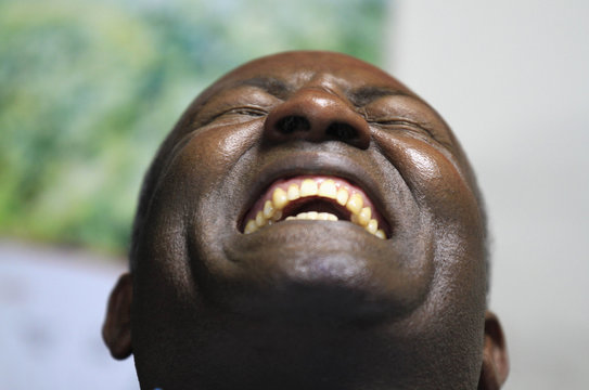 A man attends a laughter therapy exercise at Belachew Girma's laughter school in Ethiopia's capital Addis Ababa