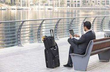 businessman working at his tablet in Dubai Marina