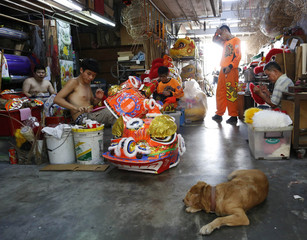Workers work at a workshop supplying lion dance costumes for Chinese Lunar New Year celebrations in Subang, outside Kuala Lumpur