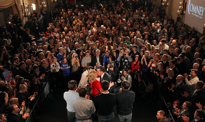 Republican presidential candidate and former Massachusetts Governor Mitt Romney kisses his wife Ann at his Iowa Caucus night rally in Des Moines