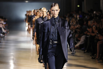 Model Karlie Kloss presents a creation by designer Anthony Vaccarello as part of his Fall/Winter 2012-2013 women's ready-to-wear fashion show during Paris fashion week