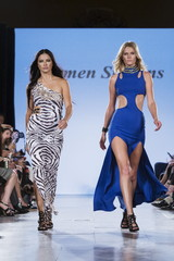 Models Adriana Lima and Toni Garrn present creations from Carmen Steffens during the FTL Moda presentation of the Spring/Summer 2016 collection during New York Fashion Week in Vanderbilt Hall at Grand Central Station, New York