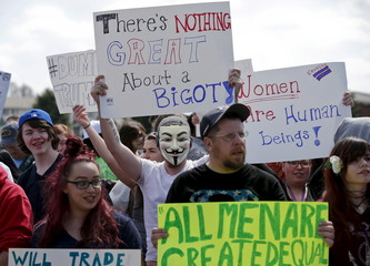 Protesters demonstrate outside a campaign rally for Republican U.S. presidential candidate Donald Trump in Janesville