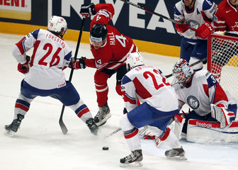 Canada's Hall tries to score past Norway's Forsberg, Roymark and Volden during their 2013 IIHF Ice Hockey World Championship preliminary round match at the Globe Arena in Stockholm